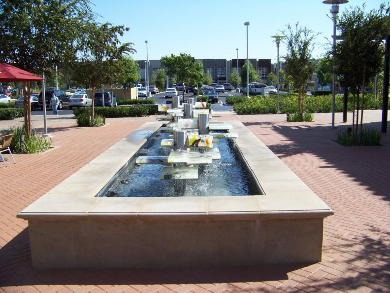 Water fountain in orange - Rectangle pool with water feature ...